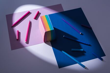 high angle view of papers, sticky notes and felt tip pens on white background