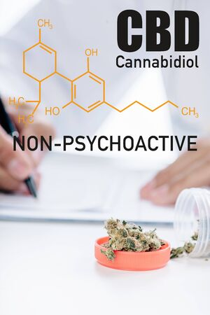 selective focus of container with medical cannabis near doctor writing prescription and non-psychoactive cbd illustration