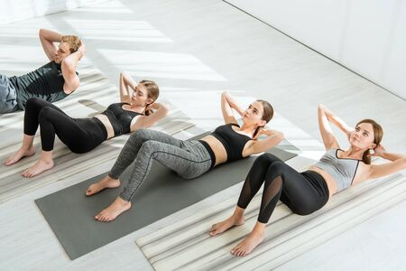 high angle view of young people practicing yoga while doing press ups