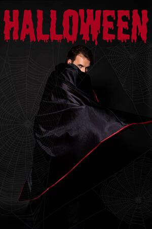 man covering face with cloak on black background with Halloween bloody illustration