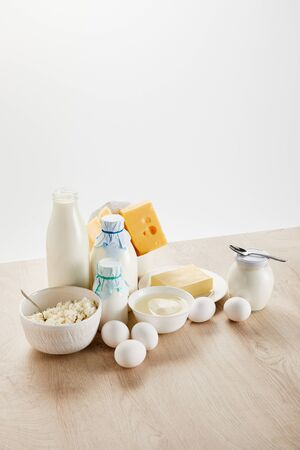 delicious organic dairy products and eggs on wooden table isolated on white 版權商用圖片