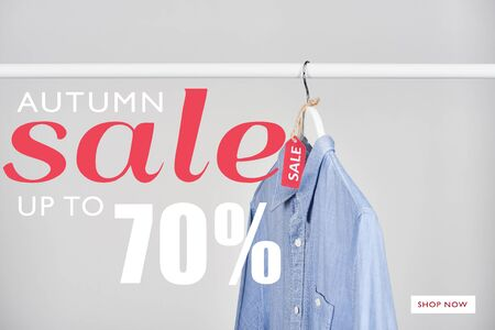 blue shirt hanging with sale label isolated on white with autumn sale, up to 70 percent illustration