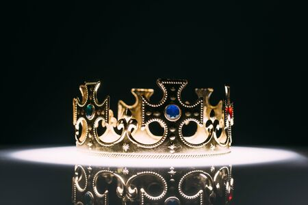 retro golden crown with gemstones on black