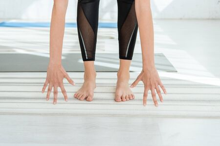 cropped view of barefoot woman practicing yoga in halfway lift pose