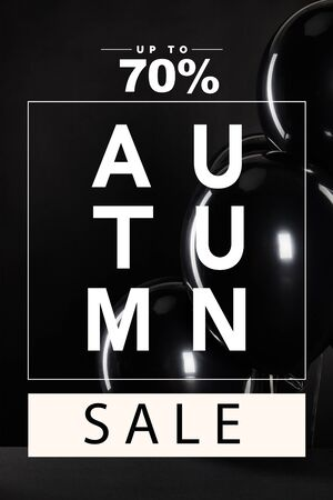 bunch of black balloons with autumn sale, up to 70 percent illustration isolated on black, black Friday concept
