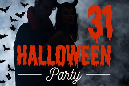 silhouette of couple in costumes standing on black with smoke and Halloween party lettering