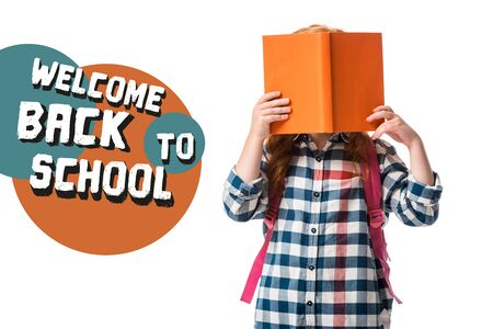 pupil covering face with orange book near welcome back to school letters on white Stock Photo