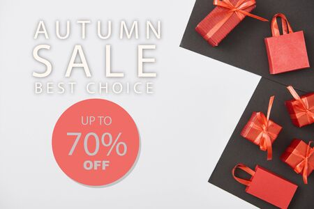 top view of red gift boxes and shopping bags on white and black background with up to 70 percent off autumn sale illustration