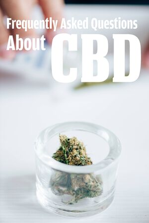 selective focus of medical marijuana buds in glass bottle with frequently asked questions about cbd illustration