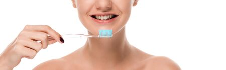 panoramic shot of naked woman smiling while holding toothbrush isolated on white 스톡 콘텐츠