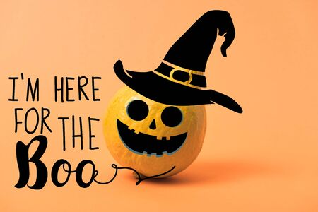 painted yellow Halloween pumpkin on orange colorful background with i am here for the boo illustration 版權商用圖片