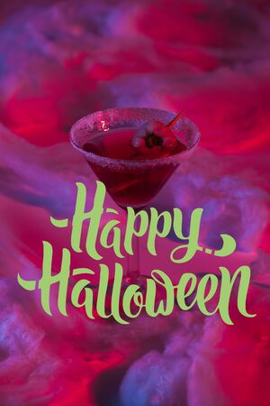 Halloween cocktail with cotton wool in red lighting with Happy Halloween illustration Stock fotó