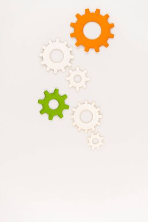 top view of colorful gears isolated on white