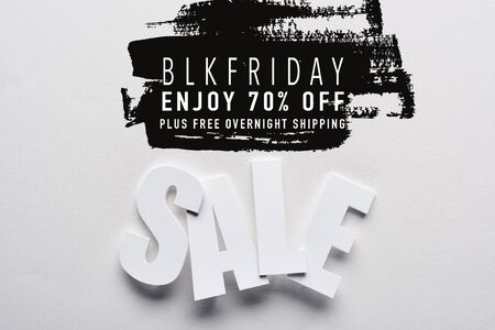 top view of white sale lettering on white background with black Friday, 70 percent off illustration
