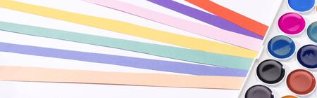 panoramic shot of watercolor and colorful paper strips isolated on white 写真素材