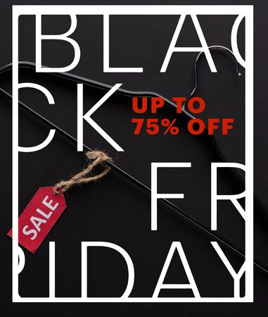 top view of hanger with sale label on black background with black Friday, up to 75 percent illustration