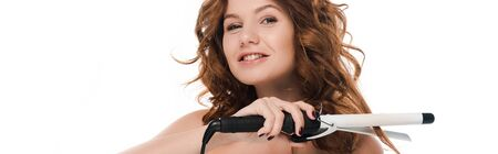 panoramic shot of happy girl curling hair isolated on white