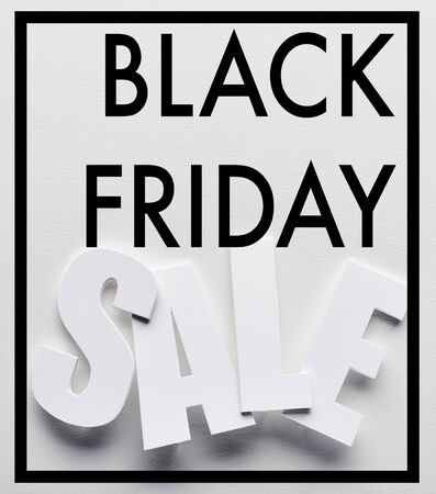 top view of black friday sale lettering on white background