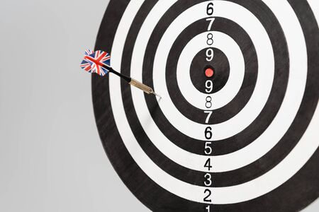 dart in darts board isolated on grey with copy space