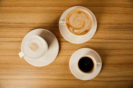 top view of saucers with white cups of tasty coffee in cafe Stock fotó