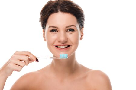 happy naked woman smiling while holding toothbrush isolated on white