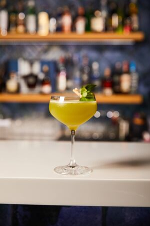 mixed alcohol cocktail in glass on bar counter
