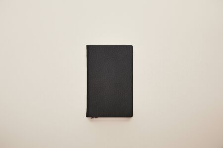 top view of black notebook isolated on beige 스톡 콘텐츠