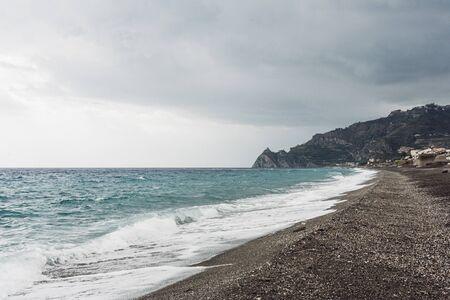 sea waves splash on sandy beach in coastline Stock Photo