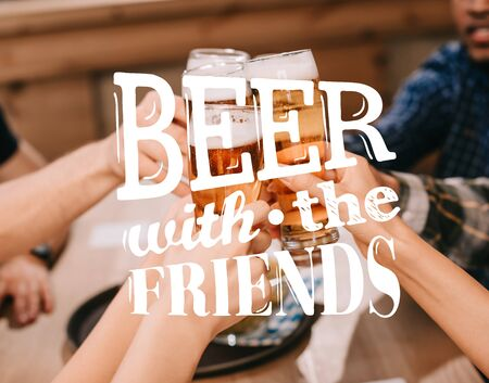 cropped view of multicultural friends clinking glasses with beer in pub with beer with the friends illustration