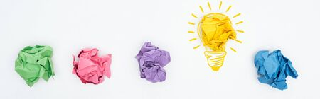 panoramic shot of multicolored crumpled paper balls and light bulb illustration on white background, business concept Stock Photo
