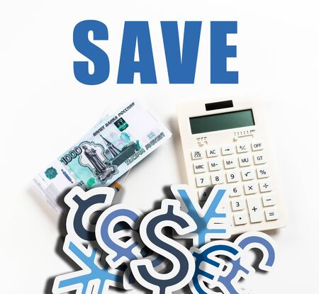 top view of calculator near russian rubles on white background with save word and currency icons