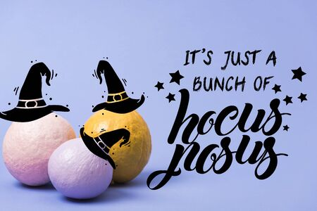 painted Halloween pumpkins on violet background with it is just a bunch of hocus pocus illustration 스톡 콘텐츠