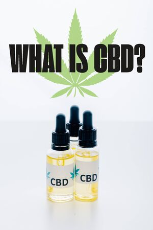 cbd oil in bottles isolated on white with what is CBD question
