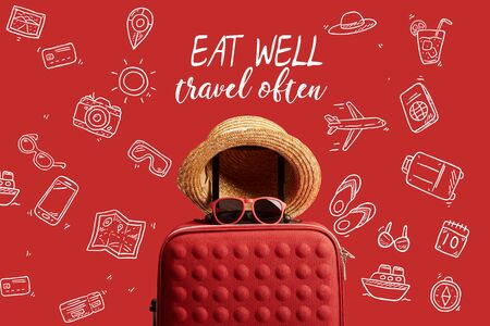 red colorful travel bag with straw hat and sunglasses isolated on red with eat well, travel often illustration