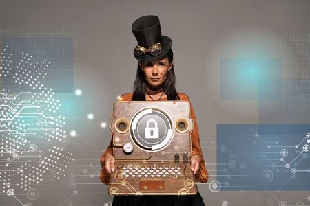 steampunk woman in top hat with goggles showing vintage laptop with internet security illustration isolated on grey