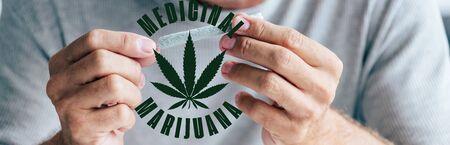 panoramic shot of man rolling blunt near medical marijuana illustration