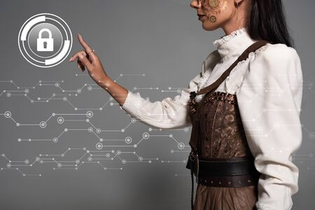 cropped view of steampunk young woman pointing with finger at lock illustration Stock fotó