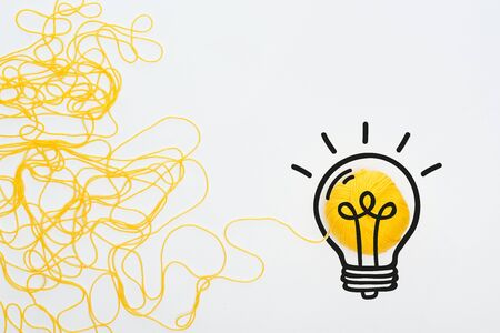 illustration of light bulb near yellow knitting ball and yarn on white background, business concept