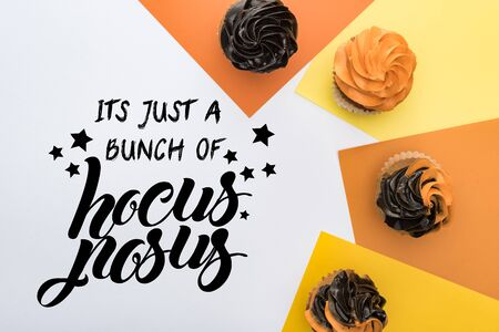 top view of delicious Halloween cupcakes on yellow, orange and white background with it is just a bunch of hocus pocus illustration