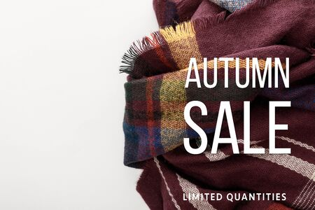 top view of burgundy wool plaid scarf on white background with autumn sale illustration