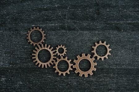top view of retro metal gears on dark wooden background with copy space Zdjęcie Seryjne