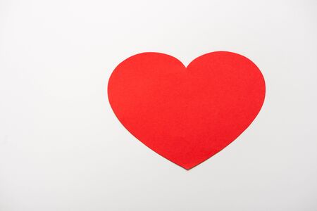 top view of red heart shape paper cut isolated on white