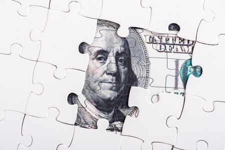 close up of puzzle pieces of dollar banknote 스톡 콘텐츠