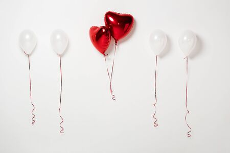 shiny and red party balloons on white Stock fotó