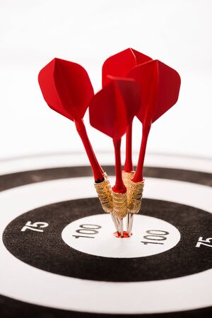 close up of black and white dartboard with red arrows isolated on white 스톡 콘텐츠