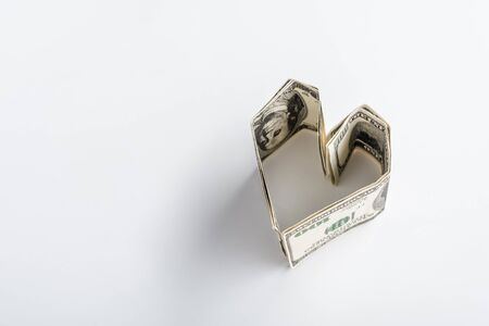 heart-shaped dollar banknotes on white with copy space