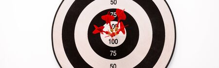 panoramic shot of black and white dartboard with red arrows isolated on white 스톡 콘텐츠