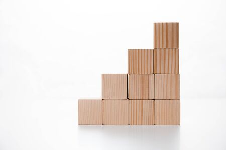 wooden cubes on white with copy space