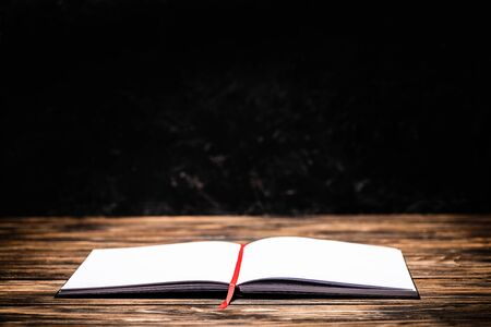 open book with red bookmark on wooden table 写真素材