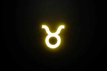 yellow illuminated Taurus zodiac sign isolated on black 版權商用圖片